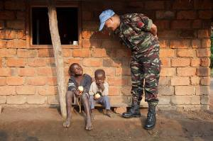 A Peacekeeper providing community out reach in Africa