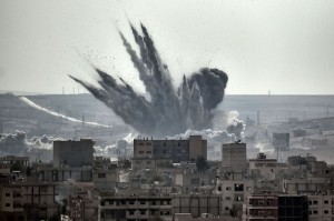 A coalition air-strike hits targets during the seige of Kobane, in defence of Kurdish forces