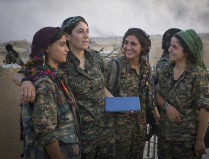 Female Peshmerga fighters take a break from combat. ISIL militants believe that if they are killed by a woman, they will not go to paradise