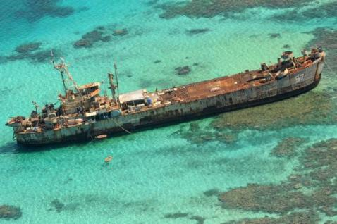 The dilapidated Philippine Navy ship LT 57 (BRP Sierra Madre) is anchored off Second Thomas Shoal. It is used as a base for a small contingent of Philippine marines to assert Filipino control. Picture: AP/Bullit Marquez Source: AAP