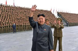 Kim Jong Un waves during a military parade in Pyongyang