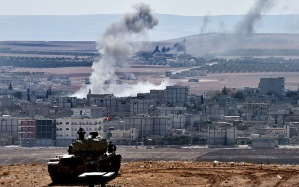 Turkish soldiers kep watch of the Seige of Kobane AFP PHOTO / ARIS MESSINISARIS MESSINIS/AFP/Getty Images