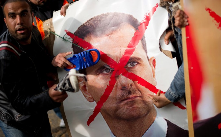 People demonstrate against the regime of President Bashar al-Assad in 2011