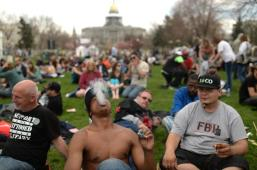 DENVER APRIL 19: Anthony Parker from New York, front, is smoking marijuana during 420 Rally weekend in Civic Center Park. Denver, Colorado. April 19. 2014. (Photo by Hyoung Chang/The Denver Post)