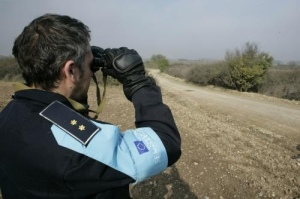 A Frontex Officer watches the border for refugees.