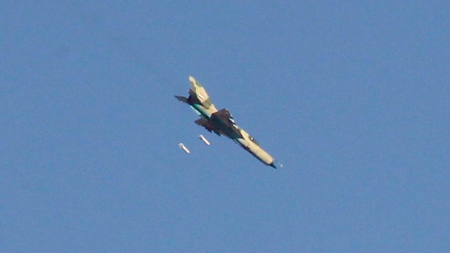 A Syrian fighter drops its payload on Rebel positions. Photo: REUTERS