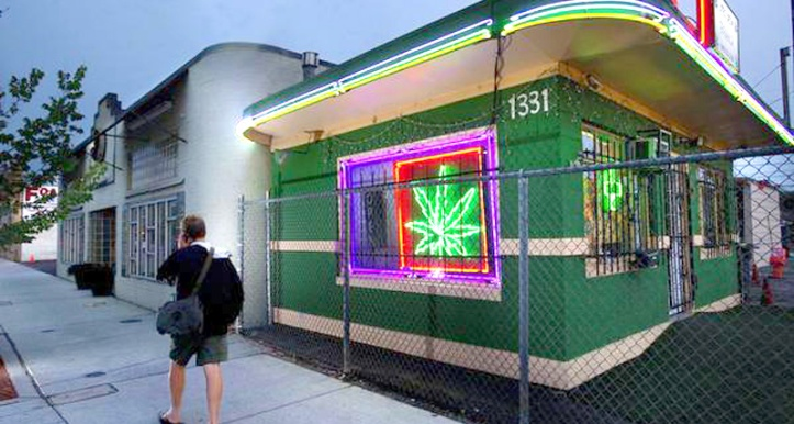 A pedestrians walks past the Little Green Pharmacy medical cannabis dispensary in Denver, Colorado, on Tuesday, August 2, 2011. (Randall Benton/Sacramento Bee/MCT)