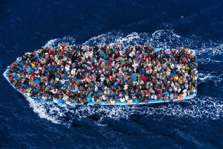 June 7, 2014 - Mediterranean Sea / Italy: Italian navy rescues asylum seekers traveling by boat off the coast of Africa. More than 2,000 migrants jammed in 25 boats arrived in Italy June 12, ending an international operation to rescue asylum seekers traveling from Libya. They were taken to three Italian ports and likely to be transferred to refugee centers inland. Hundreds of women and dozens of babies, were rescued by the frigate FREMM Bergamini as part of the Italian navy's