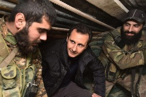 Syrian President Bashar al-Assad inspecting officers and soldiers of the National Defence Forces Source: Syria's Arab News Agency (SANA).