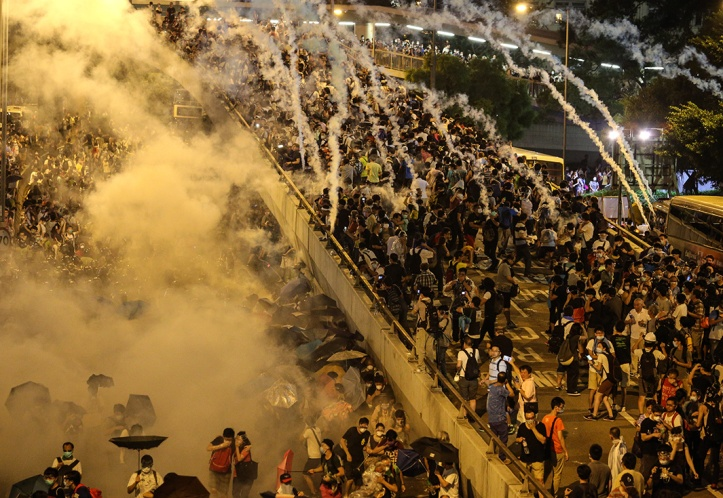Police fire tear gas upon pro-democracy demonstrators near the Hong Kong government headquarters on September 28, 2014.