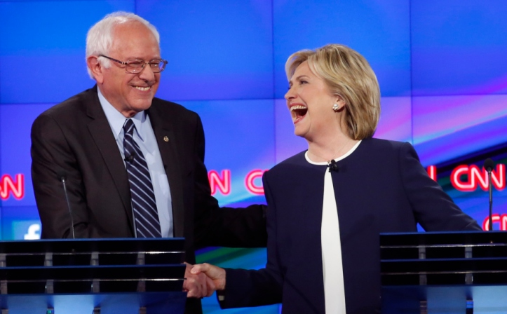 Democratic presidential candidate and former Secretary of State Hillary Clinton shakes hands with rival candidate and U.S. Senator Bernie Sanders (L) and thanks him for saying that he and the American people are sick of hearing about her State Department email controversy and want to hear about issues that effect their lives as they participate in the first official Democratic candidates debate of the 2016 presidential campaign in Las Vegas, Nevada October 13, 2015. REUTERS/Lucy Nicholson - RTS4CNF