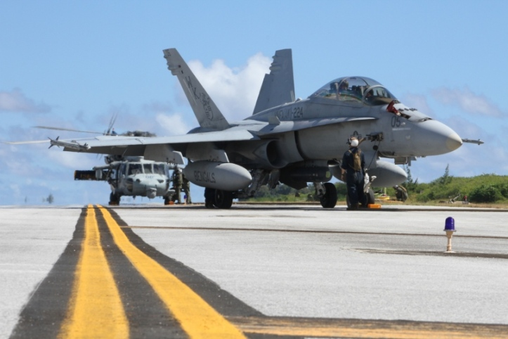 An FA-18D Hornet and a U.S. Navy MH-60S Knighthawk helicopter receive fuel on West Field on Tinian during simulated surge operation as part of Exercise Forager Fury 2012. The Navy and the Marines are exploring the possibility of expanding training opportunities in the region. U.S. MARINE CORPS PHOTO