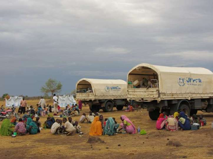 Refugees in Tissi wait to board trucks that will take them to the Ab Gadam camp.