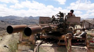 A Southern People's Resistance militant loyal to Yemen's President Abd-Rabbu Mansour Hadi mans an anti-aircraft machine gun the militia seized from the army in al-Habilin, in Yemen's southern province of Lahej March 22, 2015