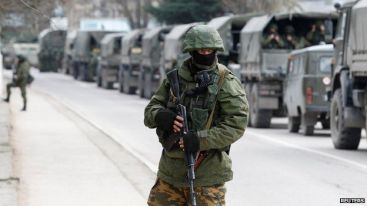 "Russian forces deployed across Crimea to ""oversee a safe referendum"" on whether Crimea would split from Ukraine. Photo: Reuters"