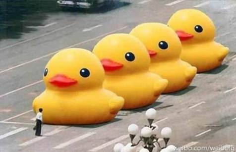 """Chinese bloggers on """"Weibo"""" risk imprisonment to parody the infamous Tank Man photo. The duck is an art installation from Hong Kong. Source: Weibo/Weibolg"""