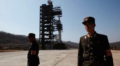North Korean military stand watch over a Satellite. Photo: Bobby Yip / Reuters
