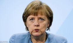 Angela Merkel is not amused. Image Credit: Reuters and Daily Mail UK