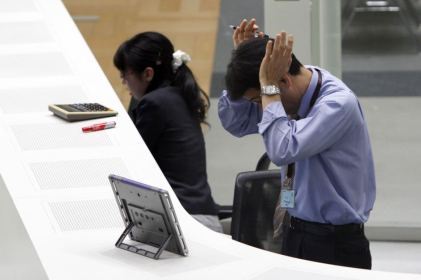 A worker feels the stress at a firm in Japan. Source: Issei Kato/Reuturs.