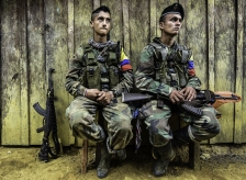 Revolutionary Armed Forces of Colombia (FARC) members rest at a camp in the Magdalena Medio region, Antioquia department, Colombia on February 18, 2016. FARC leader Timoleon Jimenez confirmed that his men were attacked by the Colombian army as they went to received one of the commanders who takes part in the Havana peace talks, who was going to inform them about the situation of the negotiations. The Marxist guerrillas have been observing a unilateral ceasefire since July. But while the government has stopped bombing FARC positions, it has yet to accede to the rebels' demand for a bilateral ceasefire. AFP PHOTO / LUIS ACOSTALUIS ACOSTA/AFP/Getty Images
