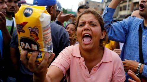 Venezuelans take to the streets to protest food shortages. Image Credit: Ivan Alvarado/Reuters