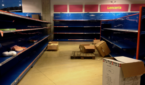 Supermarket shelves lie empty in the Venezuelan capital Caracas. Image Credit: User ZiaLater/Wikimedia Commons