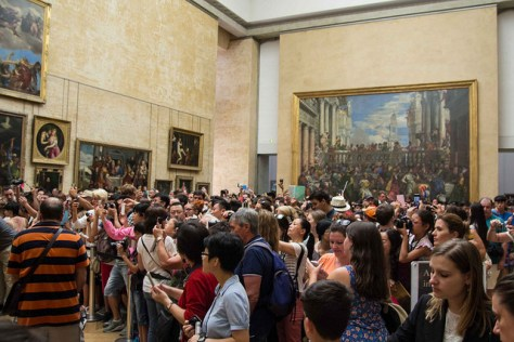 Tourists try to catch a glimpse of Mona Lisa in The Louvre, Paris. Image Credit: Steven Depolo