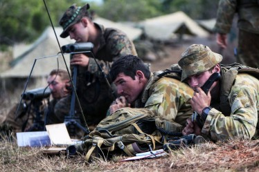 Forward observers from Battalion Landing Team 2nd Battalion, 4th Marines, 31st Marine Expeditionary Unit, and the 107 Battery, 4th Regiment, Royal Australian Artillery, coordinate artillery and mortar fire during a four-day, live-fire exercise following the conclusion of Talisman Saber 13 here, Aug. 3. The live-fire exercise included the coordination of fire-support assets from the 31st MEU; the USS Chung-Hoon, an Arleigh Burke-class AEGIS destroyer; the HMAS Perth III, an ANZAC Class frigate; and the Australian Army. The exercise provided effective and intense training to ensure U.S. and Australian forces are capable, interoperable, deployable on short notice and combat ready. The 31st MEU is the Marine Corps' force in readiness and the only continuously forward-deployed MEU. (Marine Corps photo by Sgt. Paul Robbins Jr.)