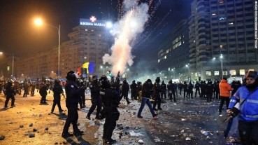 Romanian riot police fire tear gas to disperse people taking part in the protests on Wednesday.