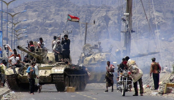 Southern Popular Resistance fighters gather on a road during fighting against Houthi fighters in Yemen's southern city of Aden