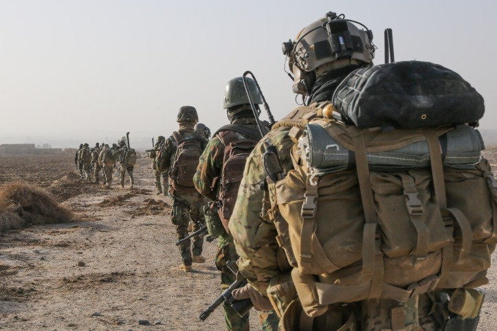 A_U.S._Army_Special_Forces_Soldier_with_Combined_Joint_Special_Operations_Task_Force-Afghanistan_and_Afghan_National_Army_commandos_with_the_3rd_Company,_3rd_Special_Operations_Kandak_move_toward_a_compound_140101-A-LW3.jpg